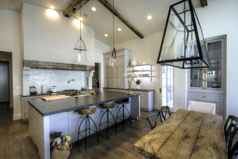 Huge new kitchen and dining room royalty free stock images