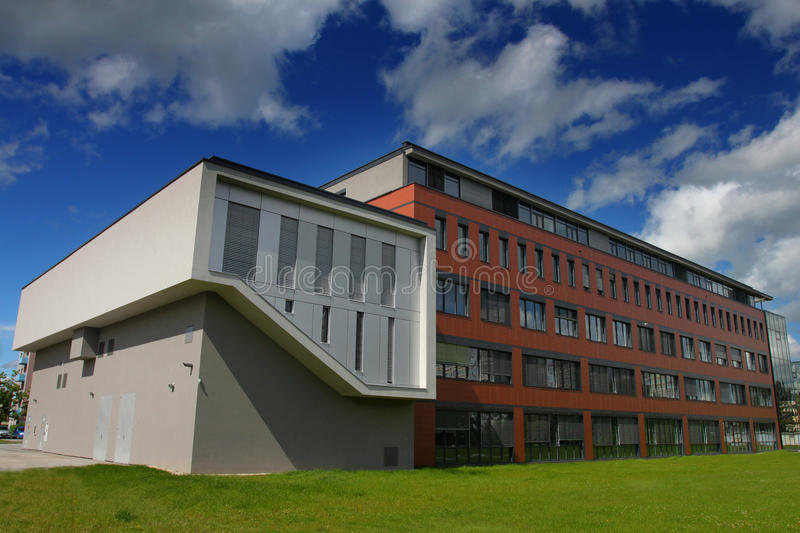New modern administration building. Exterior view with dramatic clouds stock image