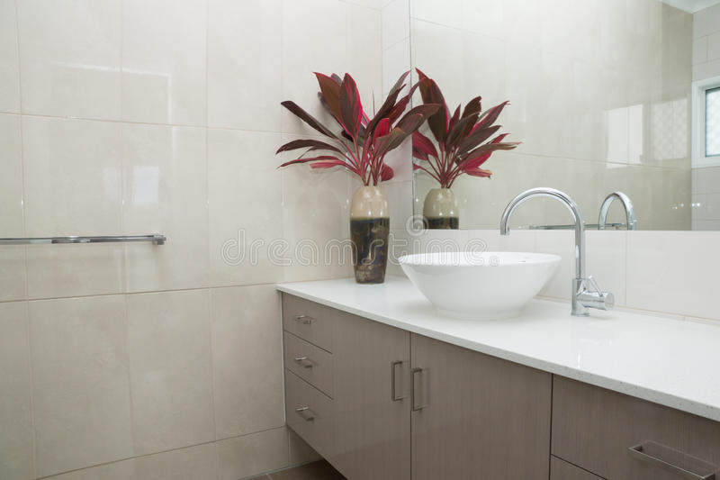 New modern bathroom. Contemporary bathroom with granite bench top and tiled walls stock photography