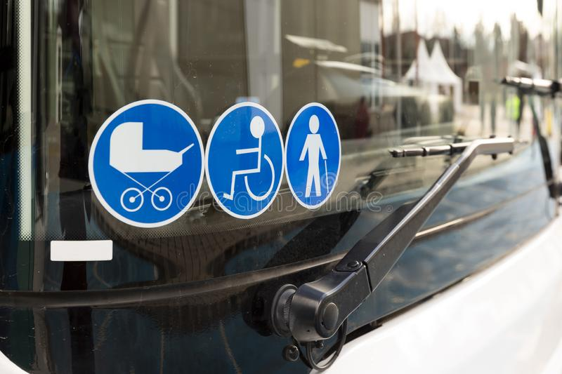 New modern bus on LPG. International Symbol of Access - Wheelchair Symbol handicapped, physically challenged and disabled, Baby Stroller Symbol and Elderly Old stock images