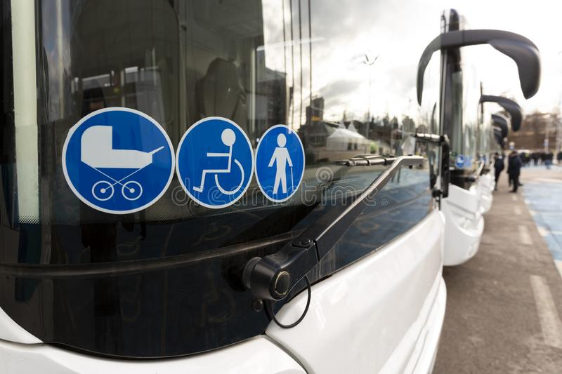 New modern bus on LPG. International Symbol of Access - Wheelchair Symbol handicapped, physically challenged and disabled, Baby Stroller Symbol and Elderly Old stock image