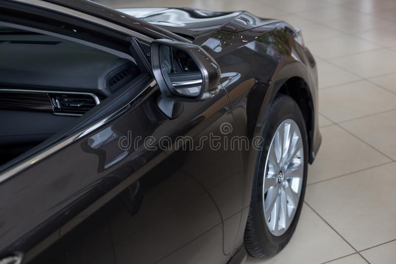New modern car at dealer showroom. Car auto dealership. Prestigious automobile stock image