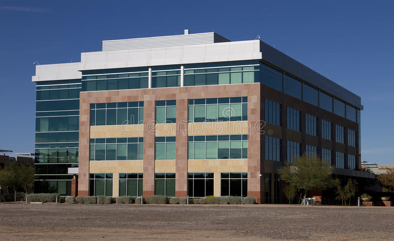New modern corporate office building exterior. New modern corporate office building in office park royalty free stock photos