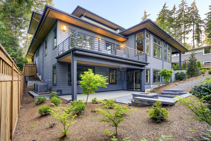 New Modern Home Features A Backyard With Patio Stock Photo - Image ...