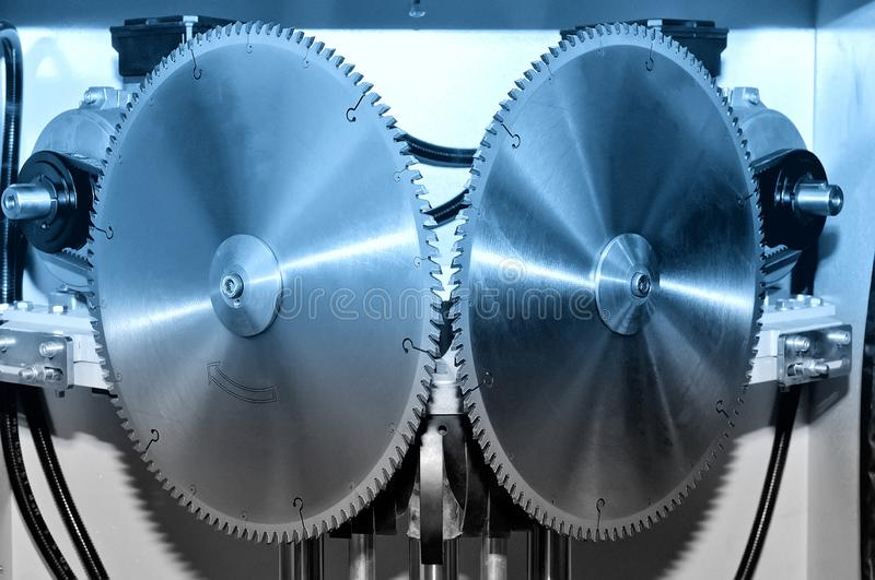 New modern industrial circular saw disks. Blue toned. Image stock image