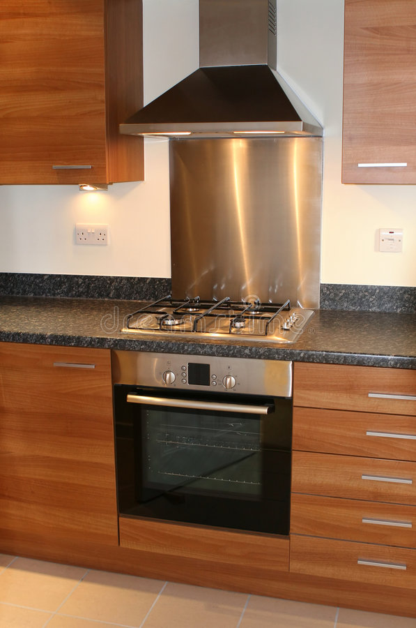 New Modern Kitchen Interior. New kitchen with integrated appliances royalty free stock photography
