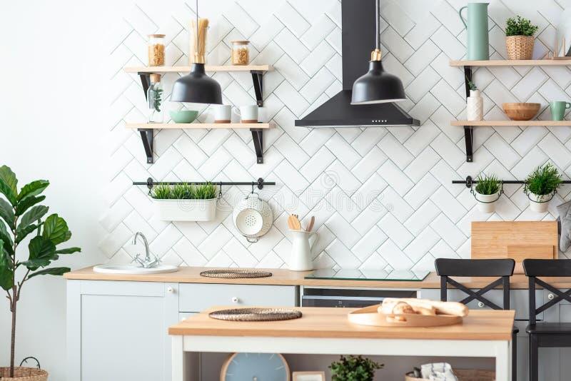New modern kitchen interior. Wooden table. interior background. New modern kitchen interior. Wooden table interior background stock image