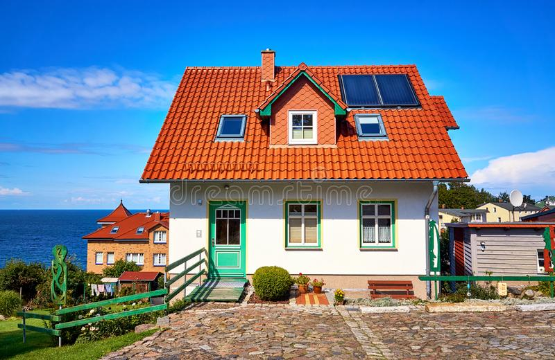 New modern single family house with red roof tiles and solar panels. Living overlooking the Baltic Sea on the island of Rügen royalty free stock image