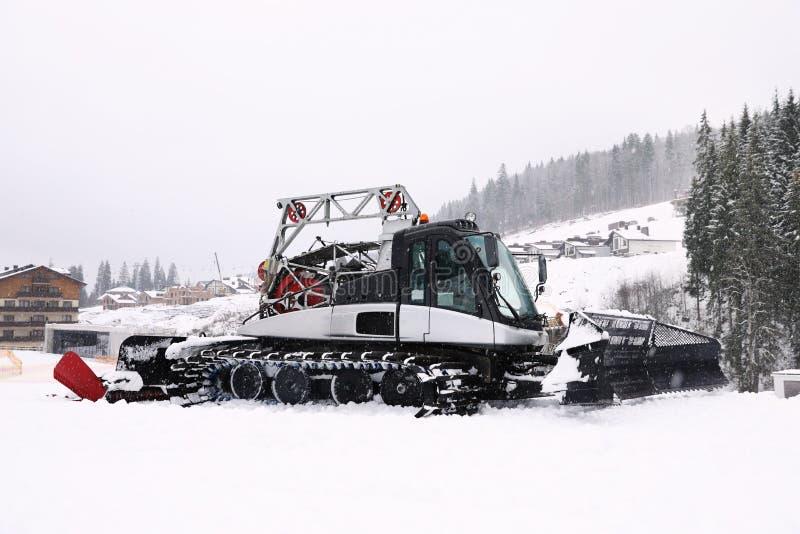 New modern snow plow at resort. New modern snow plow at mountain resort stock photo