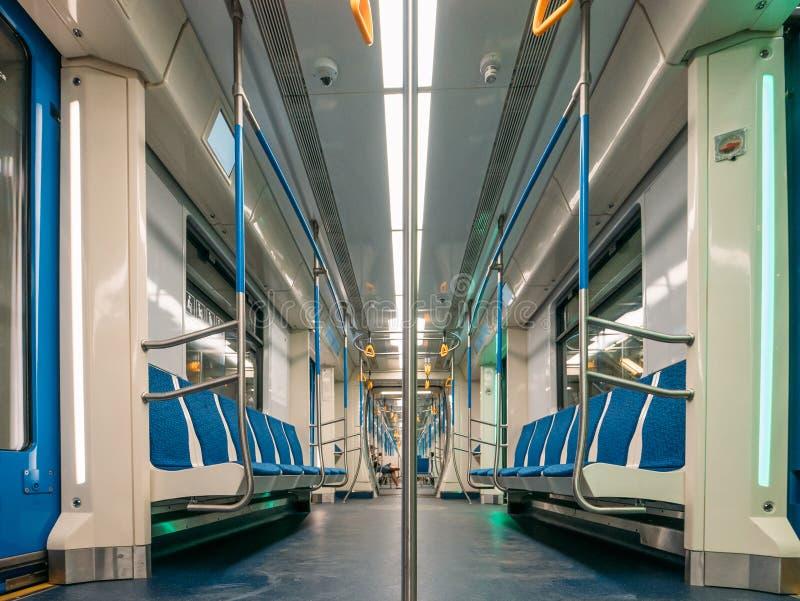 New modern subway metro train inside interior, empty public transport stock image