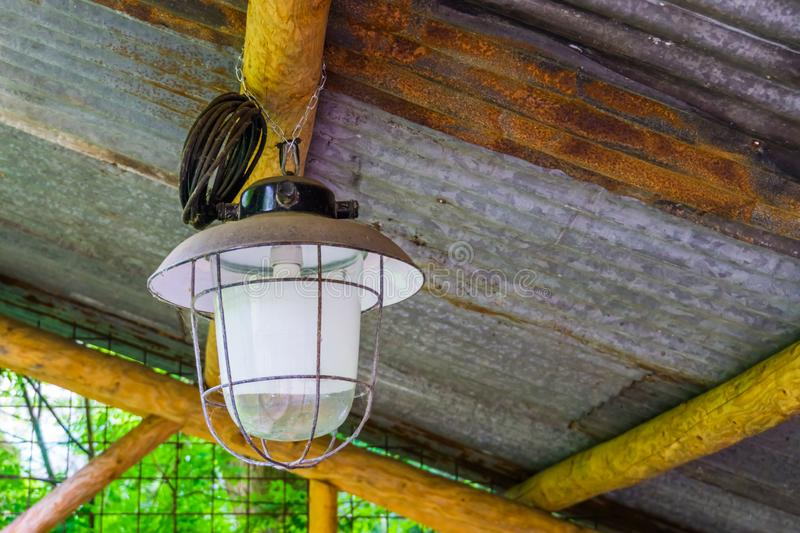 New modern vintage looking lantern hanging on the ceiling, outdoor lighting. A new modern vintage looking lantern hanging on the ceiling, outdoor lighting stock photo