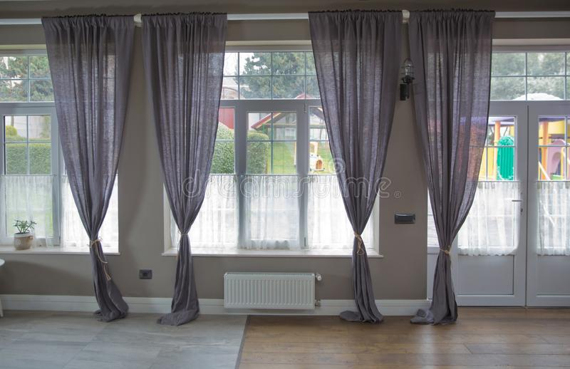 New modern window with curtains in room .Empty curtain interior in bedroom with sunlight .Purple curtain . Curtain interior royalty free stock photos