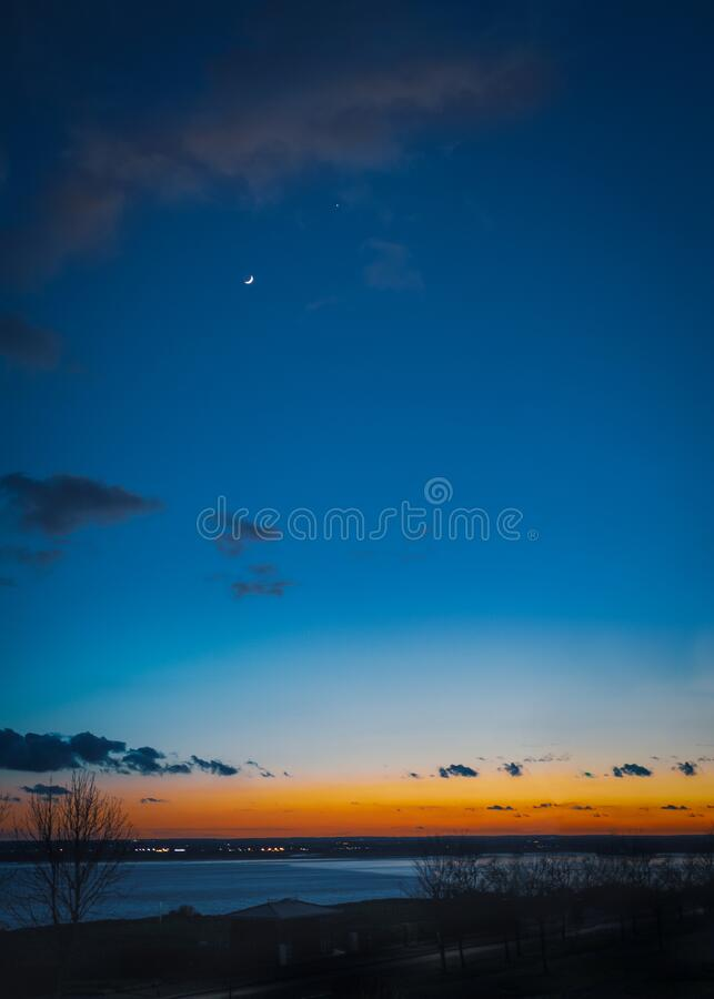 Free New Moon And Venus Over Pegwell Bay Just After Sunset When The Sky Is A Depp Blue With An Intense Orange And Red Glow Royalty Free Stock Photos - 174230168