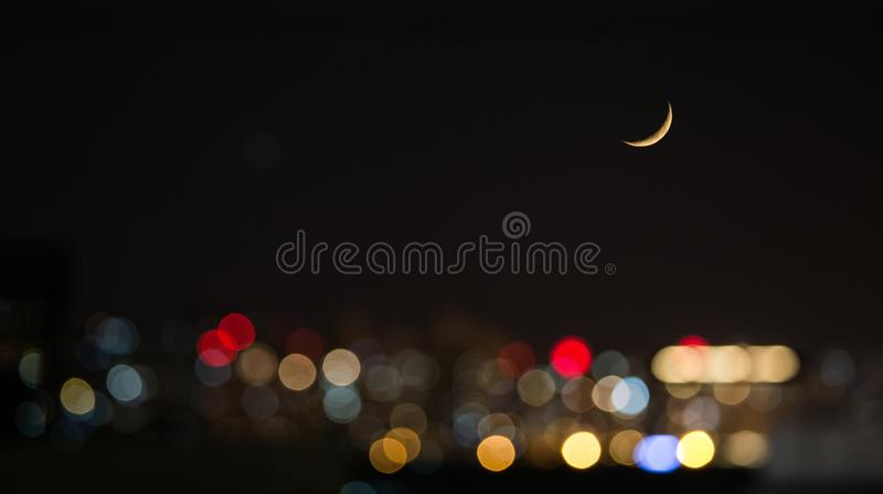 New Moon with Lens Flare royalty free stock photo