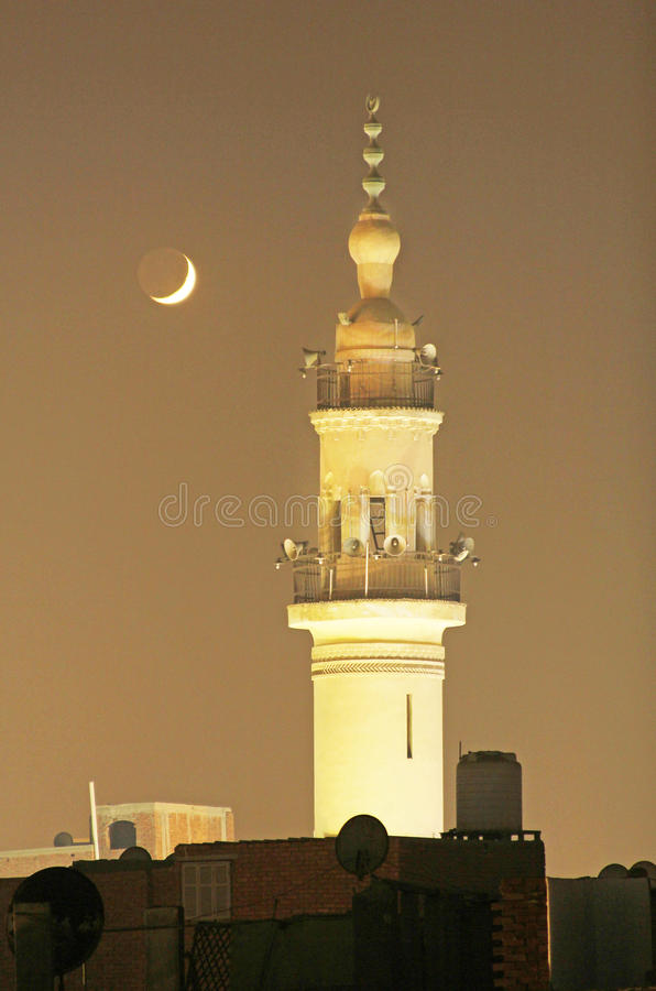 New moon or crescent with old mosque. New moon with old mosque in egyptian city called mansoura in egypt stock photography