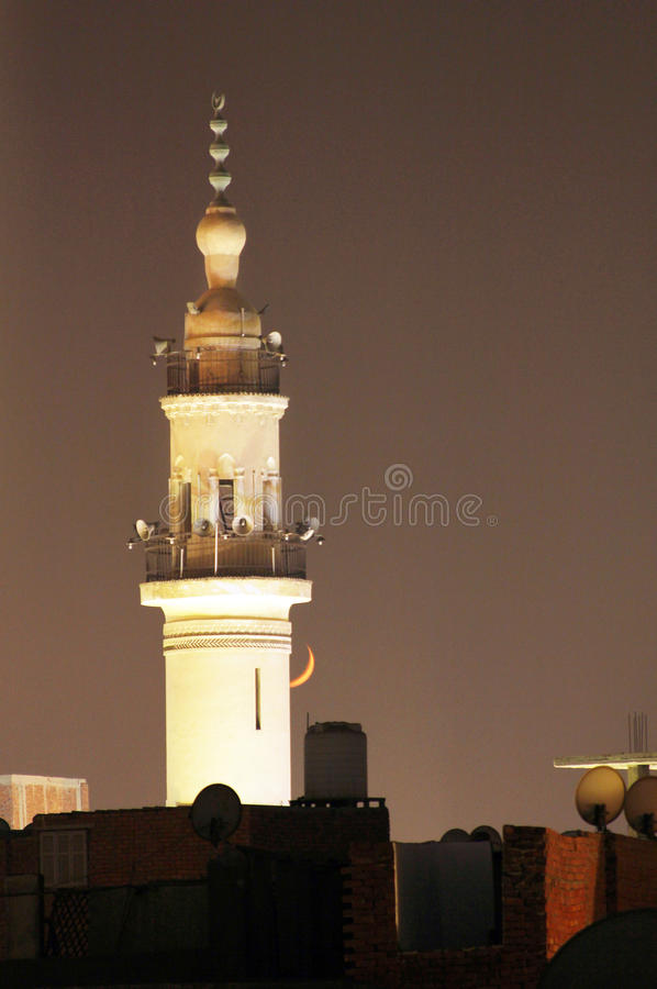 New moon or crescent with old mosque. New moon with old mosque in egyptian city called mansoura in egypt stock image