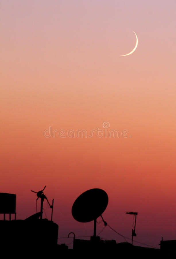The new moon or crescent during sunset in ramadan month in egypt in africa. The new moon during sunset in the first day of holy month ramadan in cairo in egypt
