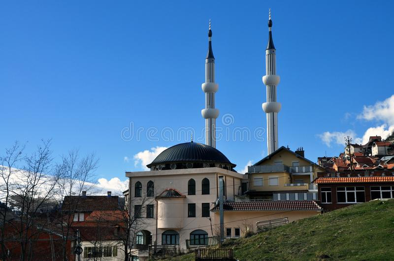 New mosque with two minarets in Restelica village. Southern Kosovo royalty free stock photography