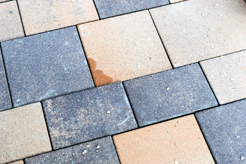 New multi colored paving stones. In the driveway stock photography