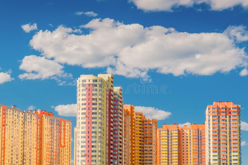 New multi-storey residential building before delivery. Against the blue sky royalty free stock photo