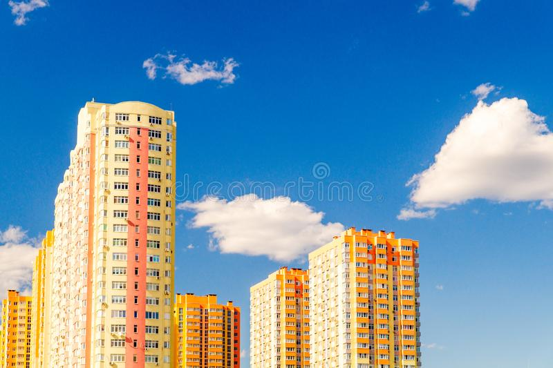 New multi-storey residential building before delivery. Against the blue sky stock photo
