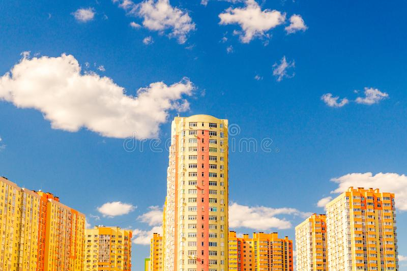 New multi-storey residential building before delivery. Against the blue sky stock photos