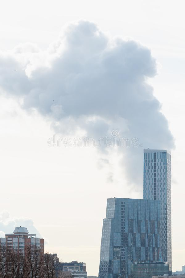 New multi-storey residential buildings on the smoke sky background. View from Victory Park on Pok royalty free stock images