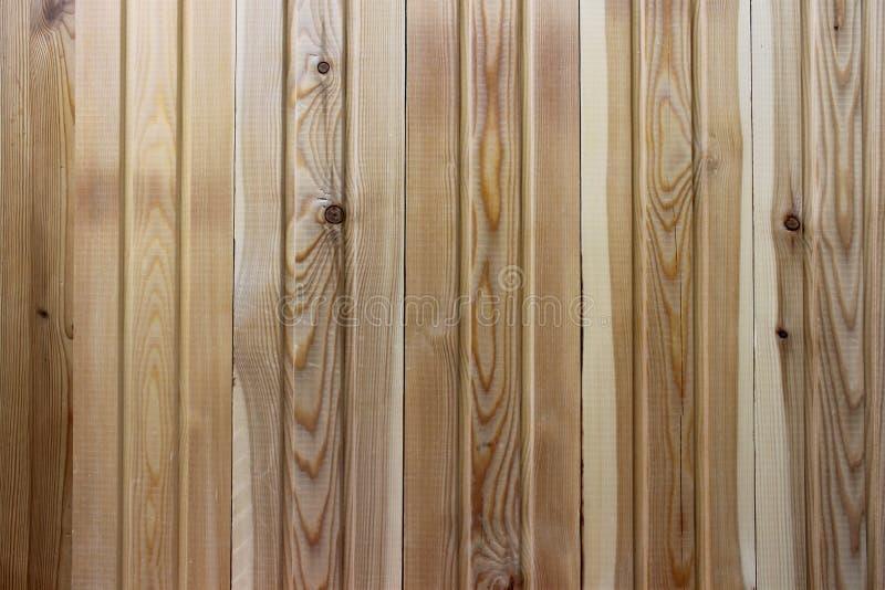 New natural yellow wood fence. Fresh panels texture. New natural yellow wood. Fresh panels texture royalty free stock image