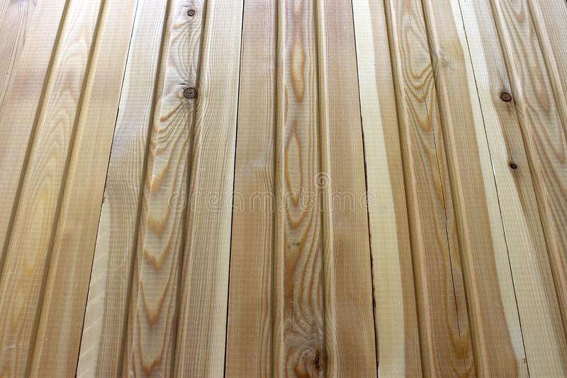 New natural yellow wood fence. Fresh panels texture. New natural yellow wood. Fresh panels texture stock photo