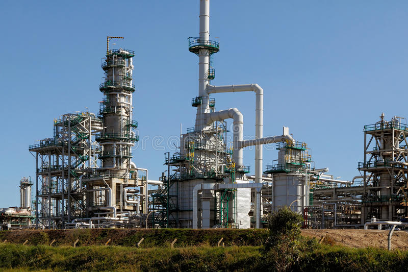New oil refinery. Part of a big oil refinery against blue sky showing some new equipment royalty free stock photos