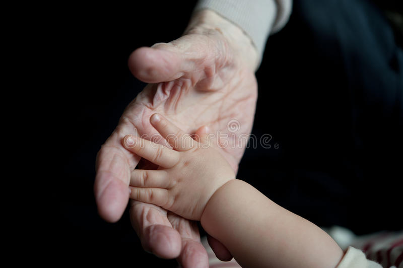 young and old hands stock images