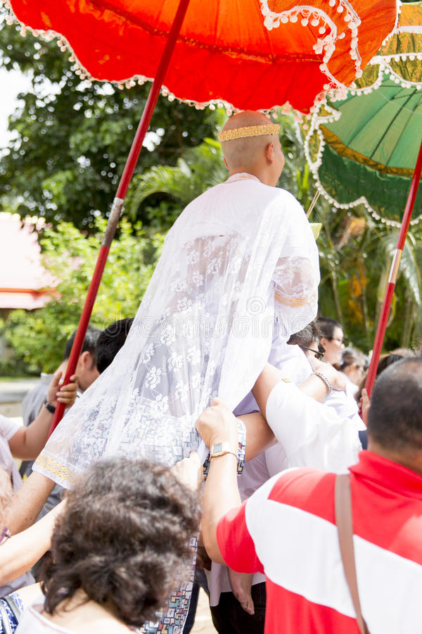 New ordained monk praying with a Thai Buddhist monk procession when male over 20 years old. stock photography