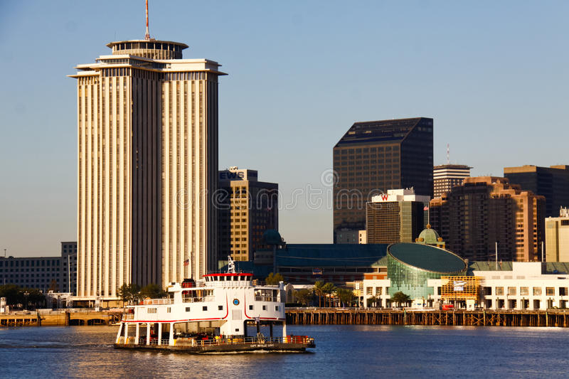 New Orleans - Algiers Ferry Run. An early morning shot from the Mississippi River of the hotels, aquarium and the popular Algiers Ferry making it's way from the stock photo