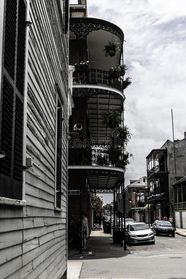 New Orleans French Quarter and its iconic balconies. The iconic balconies of the french quarter in New Orleans LA, make this street recognizable as much as the royalty free stock image