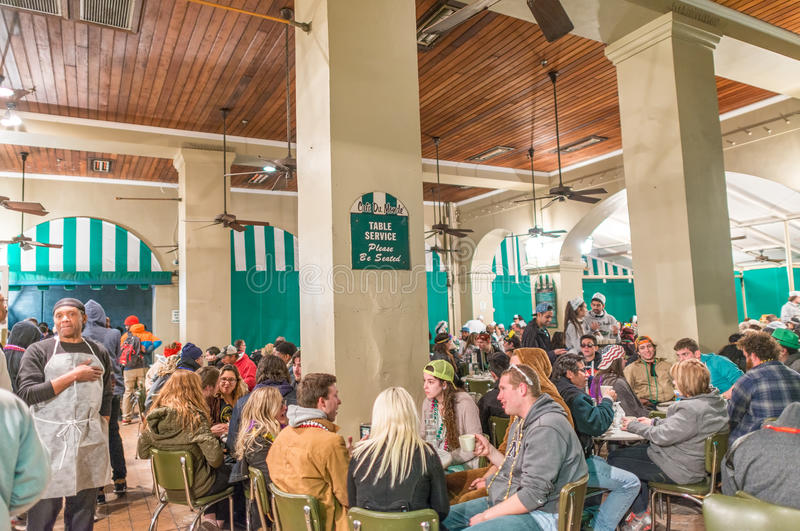 NEW ORLEANS - JANUARY 20, 2016: Cafe du Monde with tourists inside. The cafe is the most famous in New Orleans royalty free stock photo
