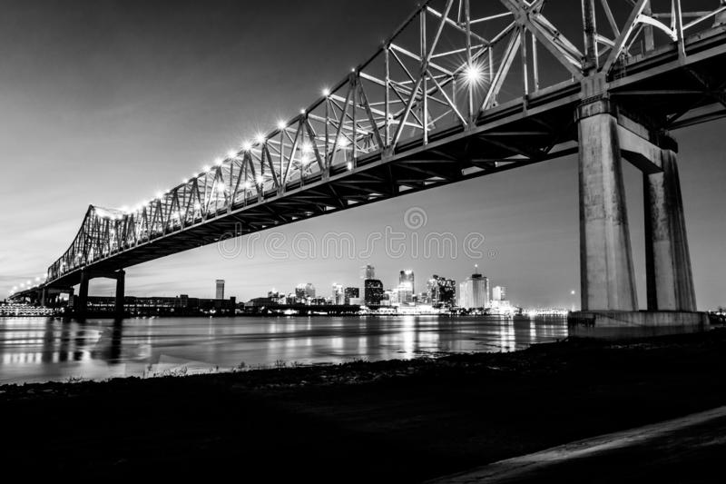 New Orleans and Crescent City Connection bridges at night. New Orleans, LA: Crescent City Connection Greater New Orleans Bridge, cantilever bridge carrying stock photos
