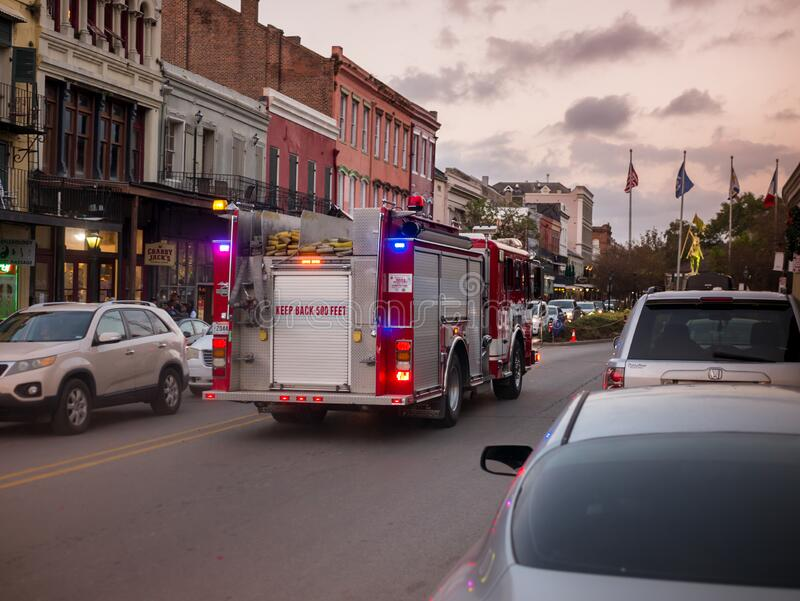 New Orleans, LA, USA. December 2019. A fire truck heads to a fire site on Decatur st.  royalty free stock photography