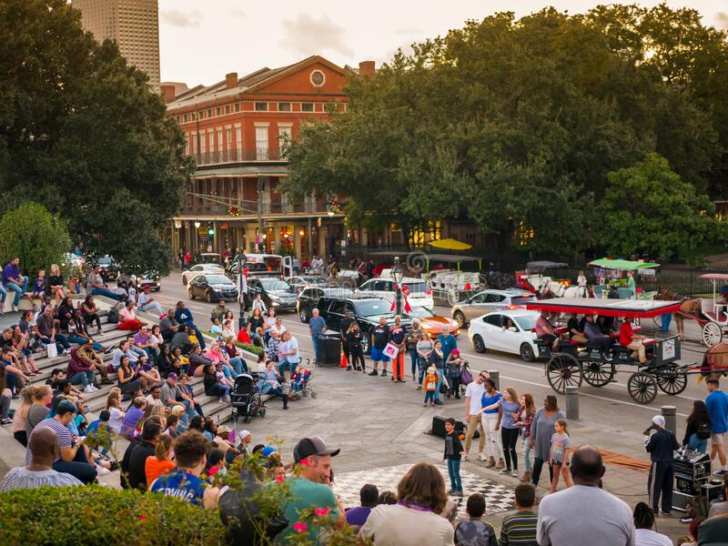New Orleans, LA USA. December 2019. People watch street entertainers in the famous Washington Artillery Park stock image