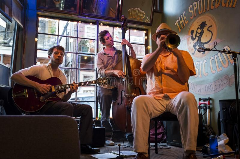 Jazz band playing at the Spotted Cat Music Club in the city of New Orleans, Louisiana. New Orleans, Louisiana - June 20, 2014: Jazz band playing at the Spotted stock photography