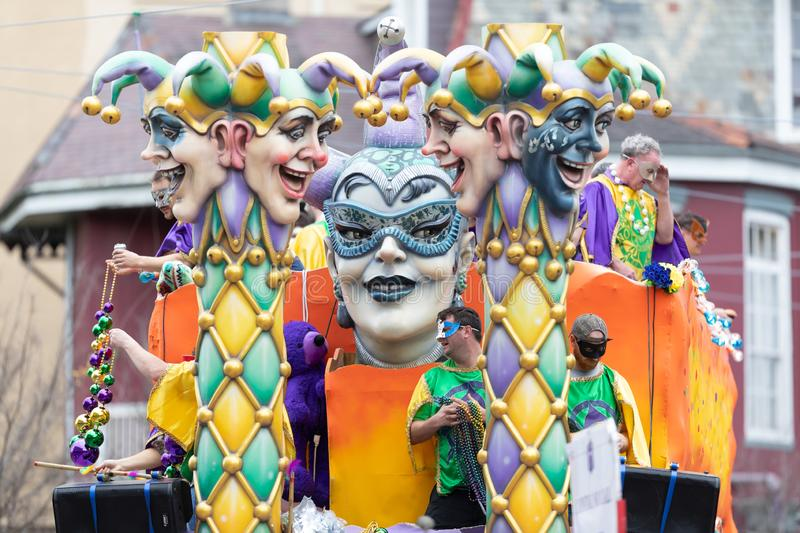 Mardi Gras Parade New Orleans. New Orleans, Louisiana, USA - February 23, 2019: Mardi Gras Parade, Float with Jester heads, going down the street at the parade royalty free stock images