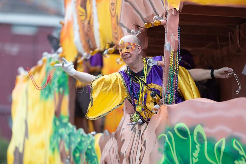 Mardi Gras Parade New Orleans. New Orleans, Louisiana, USA - February 23, 2019: Mardi Gras Parade, Man wearing traditional clothing, throwing beads to the royalty free stock photo