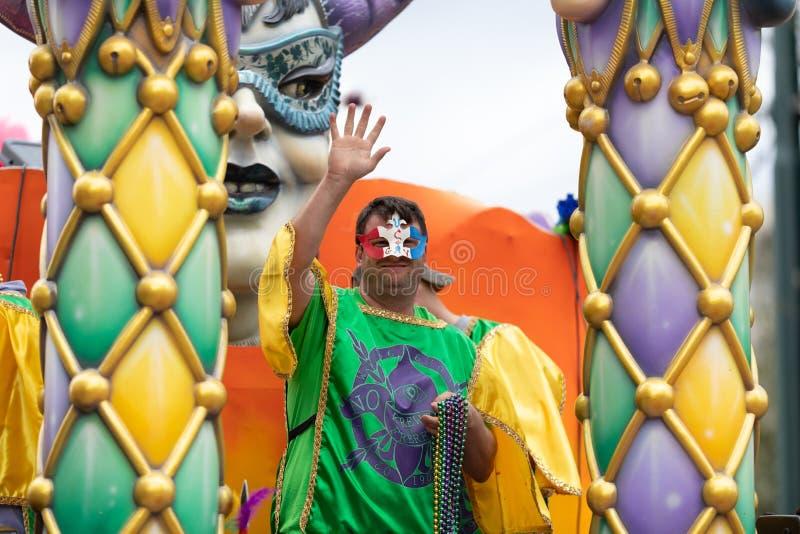 Mardi Gras Parade New Orleans. New Orleans, Louisiana, USA - February 23, 2019: Mardi Gras Parade, Man wearing traditional mardi gras clothing at the parade royalty free stock image