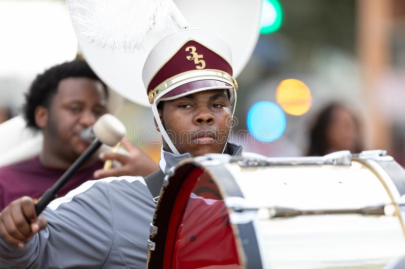 Mardi Gras Parade New Orleans. New Orleans, Louisiana, USA - February 23, 2019: Mardi Gras Parade, The McDonogh Senior High Marching Roneagles, performing at the royalty free stock photography