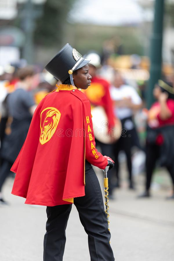 Mardi Gras Parade New Orleans. New Orleans, Louisiana, USA - February 23, 2019: Mardi Gras Parade, A member of the Paul Habans Charter School the Marching Lions royalty free stock photo
