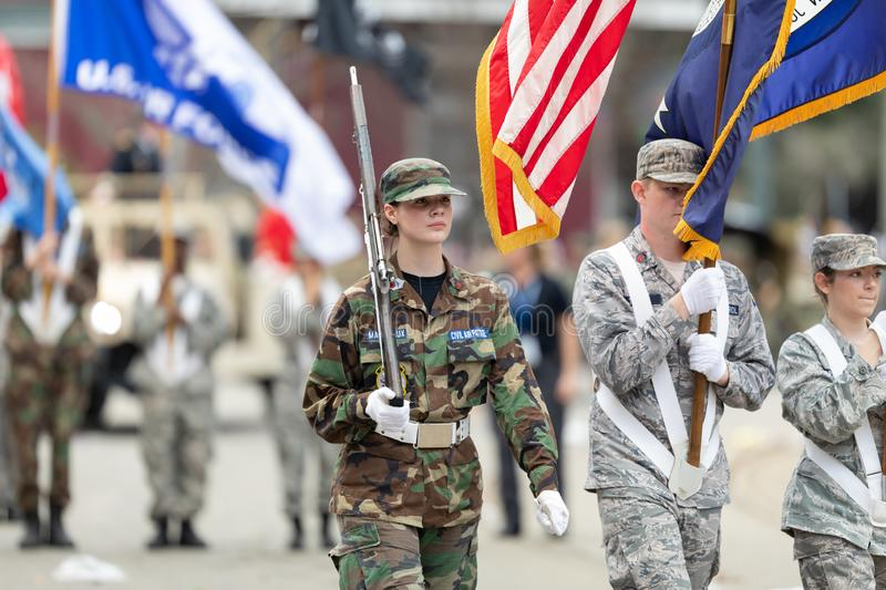Mardi Gras Parade New Orleans. New Orleans, Louisiana, USA - February 23, 2019: Mardi Gras Parade, Members of the Civil Air Patrol marching, carrying the stock photography