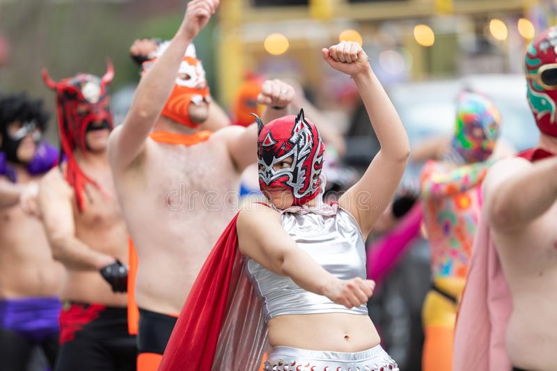 Mardi Gras Parade New Orleans. New Orleans, Louisiana, USA - February 23, 2019: Mardi Gras Parade, Members of El Lucha Krewe, Dancing at the Mardi Gras Parade stock image