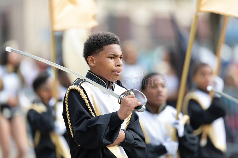 Mardi Gras Parade New Orleans. New Orleans, Louisiana, USA - February 23, 2019: Mardi Gras Parade, The Roots Of Music Marching Crusaders Performing at the parade stock image