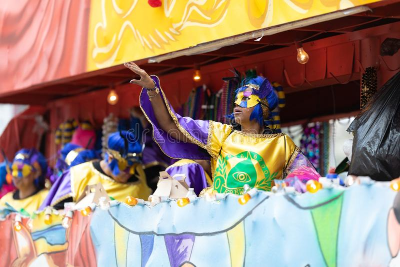 Mardi Gras Parade New Orleans. New Orleans, Louisiana, USA - February 23, 2019: Mardi Gras Parade, Woman wearing traditional clothing, throwing beads to the royalty free stock photography