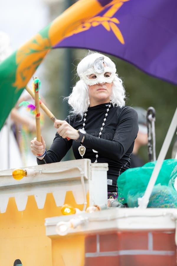 Mardi Gras Parade New Orleans. New Orleans, Louisiana, USA - February 23, 2019: Mardi Gras Parade, Woman wearing traditional mardi gras clothing at the parade stock photo