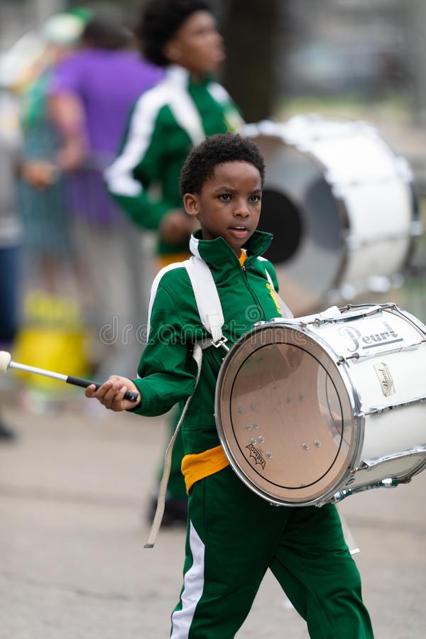 Mardi Gras Parade New Orleans. New Orleans, Louisiana, USA - February 23, 2019: Mardi Gras Parade, Young Boy Member of Crocker College Prep playing the drum at royalty free stock photo